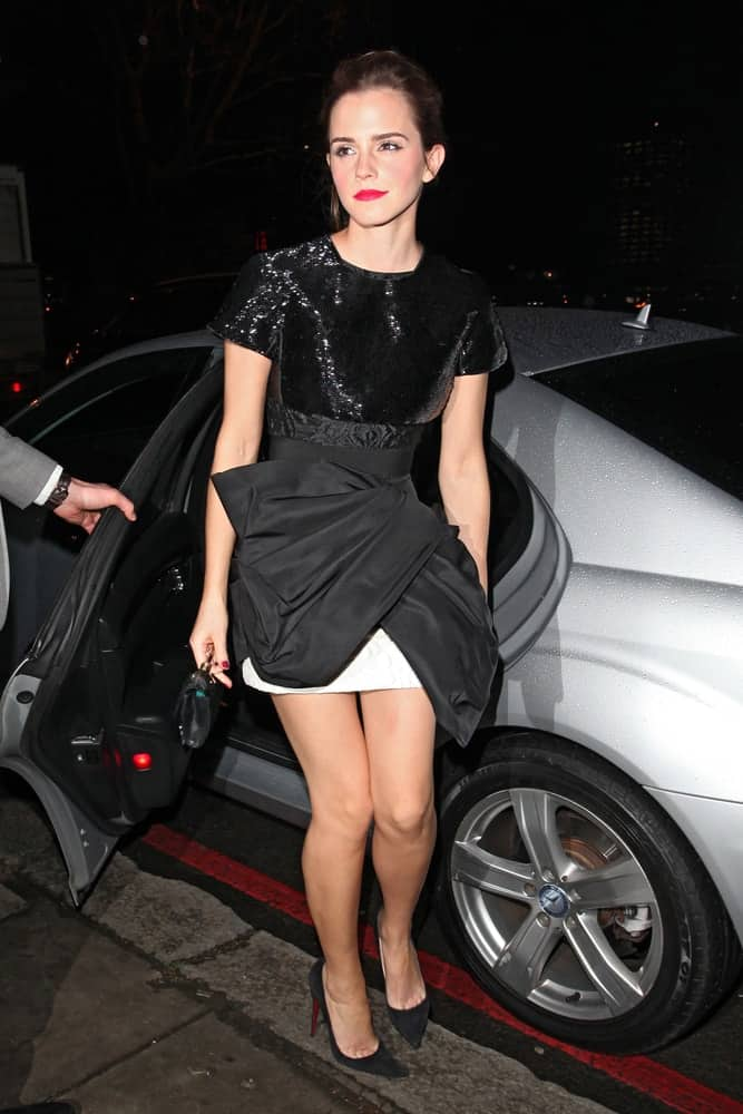 Emma Watson wore a fashionable and stylish short dress with her bold lips and loose bun hairstyle that has a few tendrils on the sides when she attended the Elle Style Awards 2014 at one Embankment on February 18, 2014 in London, England.