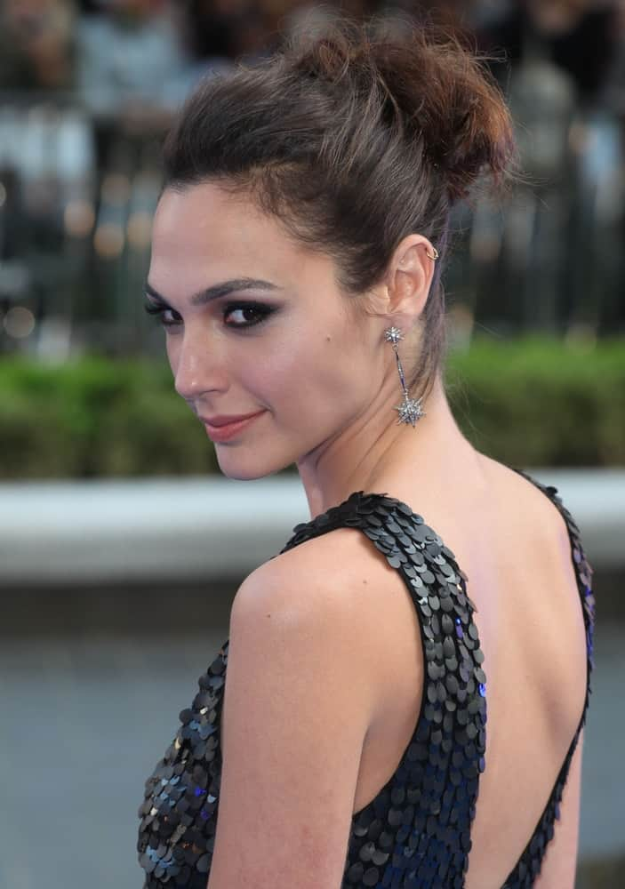 Gal Gadot attended the 'Fast And Furious 6' Premiere, in the Empire Leicester Square, London on May 7, 2013. She wore a stunning black dress that paired perfectly with her messy upstyle bun hairstyle with loose tendrils.