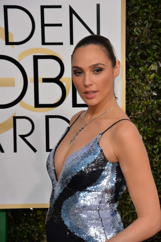 On January 8, 2017, Gal Gadot attended the 74th Golden Globe Awards at The Beverly Hilton Hotel, Los Angeles. She was wearing a black and silver shimmering dress to pair with her slicked back raven hairstyle.