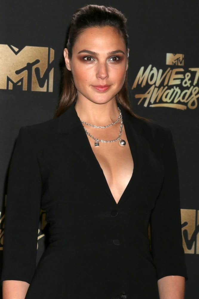 Gal Gadot attended the MTV Movie and Television Awards at the Shrine Auditorium on May 7, 2017 in Los Angeles, CA. She came with a stunning black outfit to pair with her slicked-back half-up straight hair with subtle highlights.