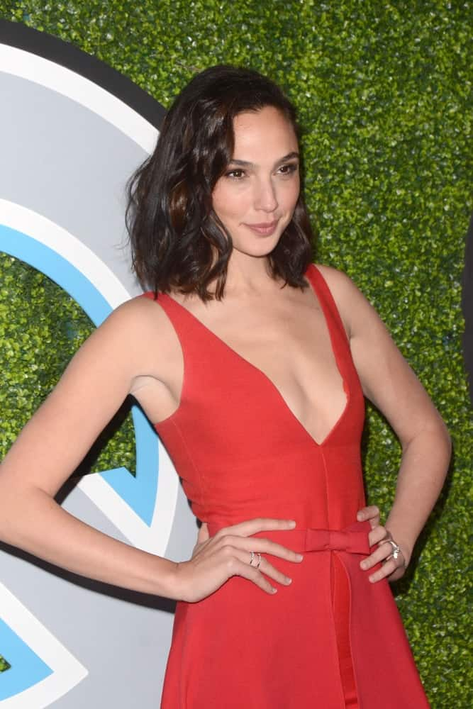 Gal Gadot attended the 2017 GQ Men of the Year at the Chateau Marmont on December 7, 2017 in West Hollywood, CA. She paired her lovely red dress with a shoulder-length tousled wavy hairstyle.