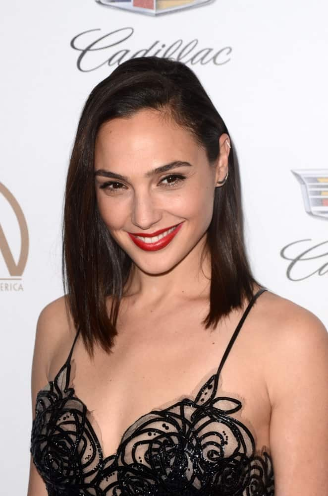 Gal Gadot was at the Producers Guild Awards 2018 at the Beverly Hilton Hotel on January 20, 2018 in Beverly Hills, CA. She came in a detailed black dress that pairs perfectly with her shoulder-length straight dark hairstyle with a side-swept finish.