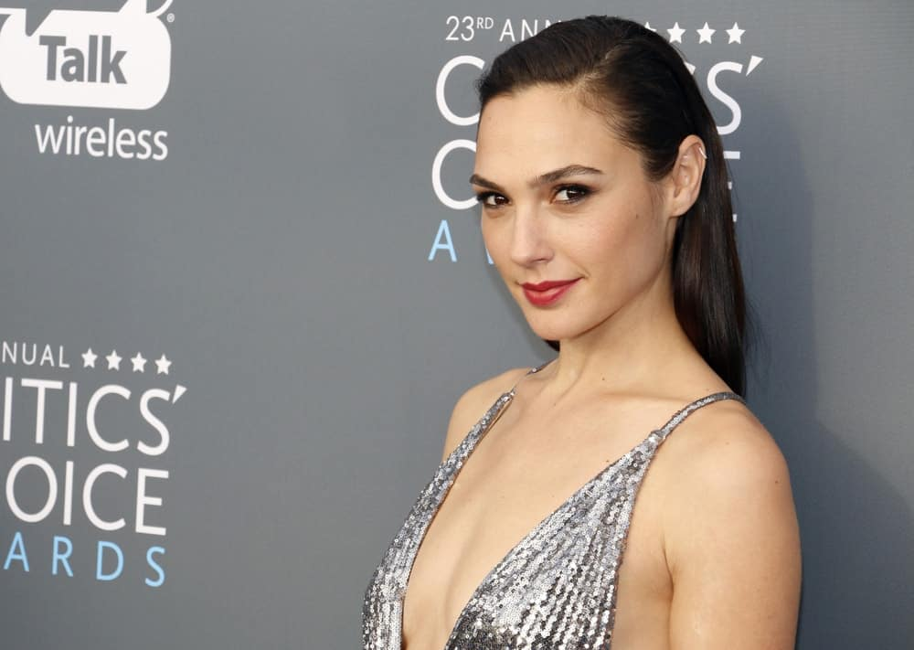 Gal Gadot attended the 23rd Annual Critics' Choice Awards held at the Barker Hangar in Santa Monica, USA on January 11, 2018. She paired her silver dress with a slicked back raven hairstyle and red lips.