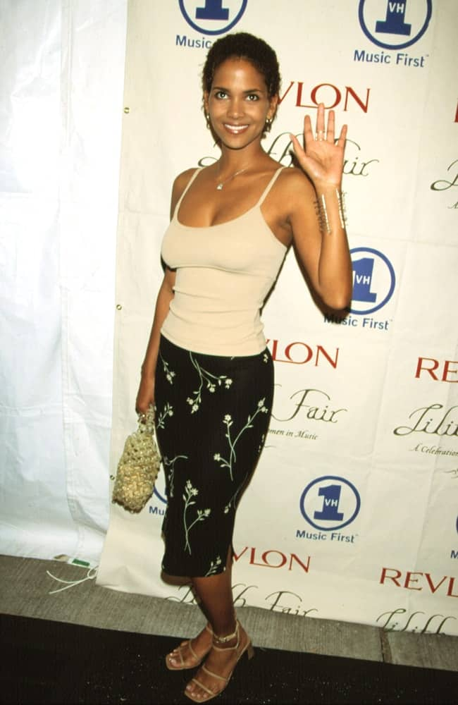 Halle Berry was at the 1998 VH-1 Lilith Rocks for Women's Health Gala. She wore a casual black floral skirt with her sexy top and short curly hair.