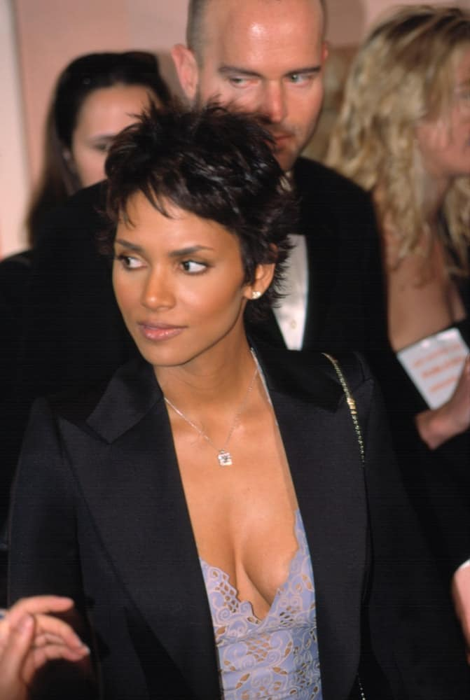 On January 5, 2001, Halle Berry wore a smart casual jacket on her purple embroidered dress to match with her spiky short hair at the 2001 AMERICAN FILM INSTITUTE AWARDS in Los Angeles, CA.