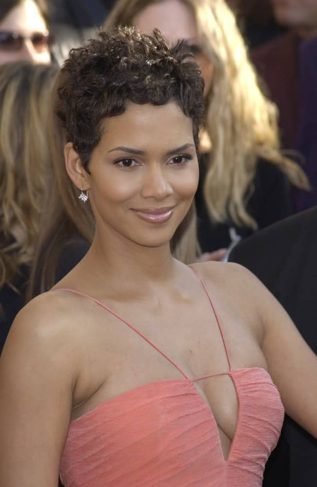 Halle Berry wore a sexy coral dress with thin straps to match her raven curly pixie hairstyle at the 9th Annual SCREEN ACTORS GUILD AWARDS in Los Angeles on March 9, 2003.