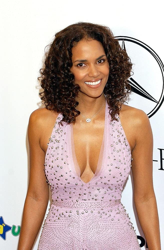 Halle Berry was lovely in her studded dress that she paired with her shoulder-length curly hair at the 16th ANNUAL CAROUSEL OF HOPE GALA to benefit the Barbara Davis Center for Childhood Diabetes in Beverly Hills, CA on October 23, 2004.
