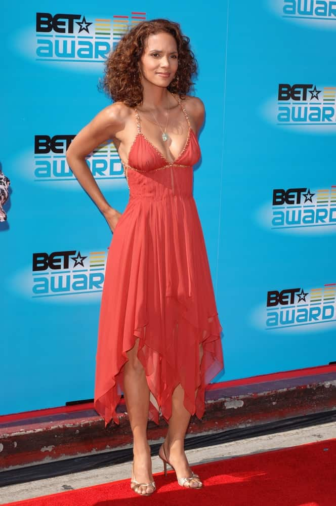 Actress Halle Berry wore a sexy coral sun dress with her loose and tousled shoulder-length curly hairstyle at the 2005 BET (Black Entertainment Television) Awards at the Kodak Theatre in Hollywood on June 28, 2005.