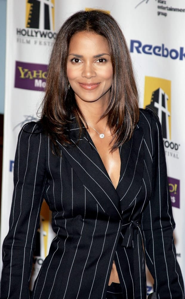Halle Berry added a sexy spin to her smart casual pin-striped outfit that she paired with her shoulder-length layered hairstyle with highlights at the Hollywood Film Festival Awards Gala Ceremony held at the Beverly Hilton Hotel in Beverly Hills on October 24, 2005.