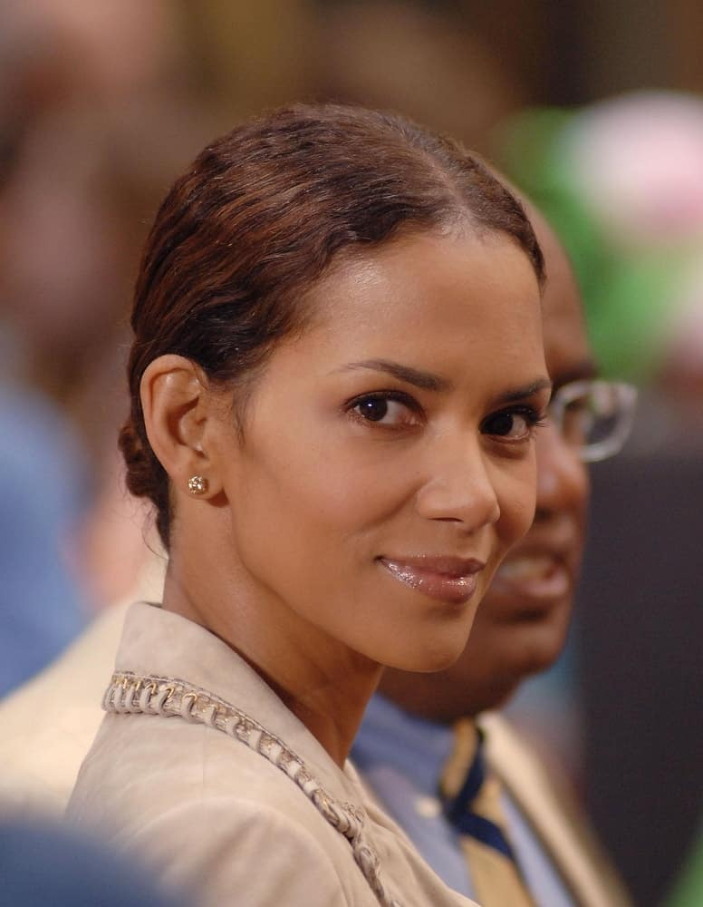 Halle Berry swept her curly highlighted hair into a neat low bun on location for the NBC Today Show held at the Rockefeller Center in New York, NY on May 26, 2006.