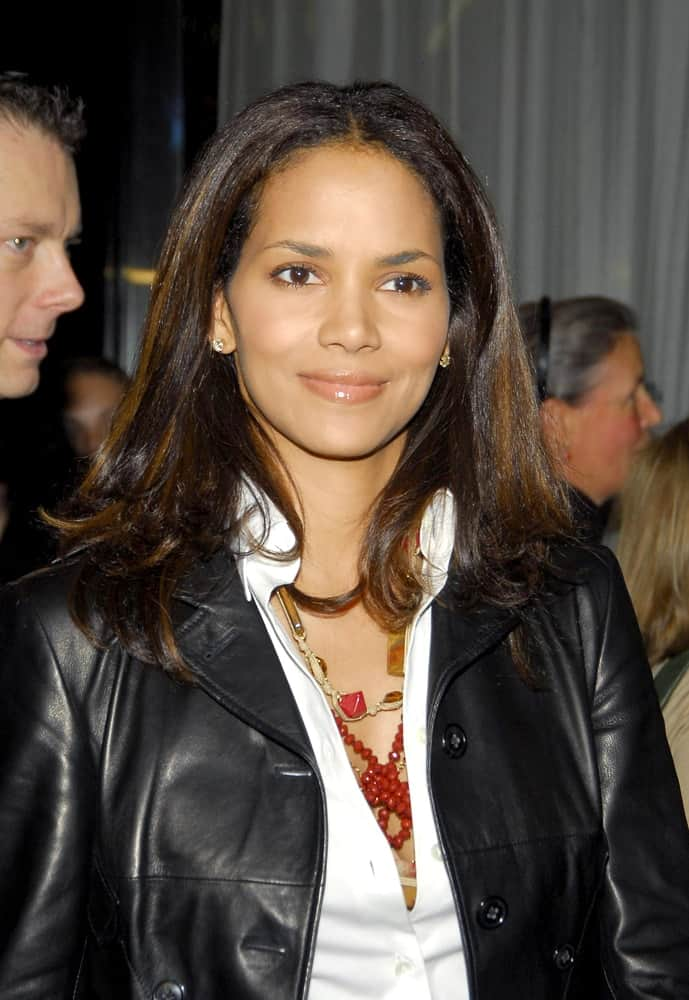 Halle Berry wore a black leather jacket over her white button down shirt medium-length straight hair with highlights at the