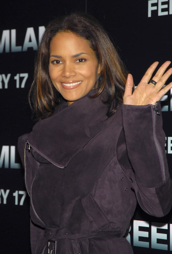 Halle Berry wore a comfortable black velvet winter coat to pair with her straight layered hair with highlights at the FREEDOMLAND Premiere in Loews Lincoln Square Theater, New York on February 13, 2006.