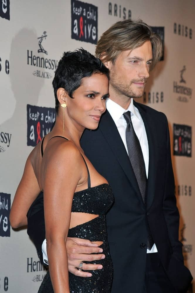 Halle Berry and Gabriel Aubry were at Keep a Child Alive 6th Annual Black Ball Fundraiser, Hammerstein Ballroom in New York, NY on October 15, 2009. They wore matching black outfits with Berry topping it off with a spiked pixie hairstyle to her raven hair.