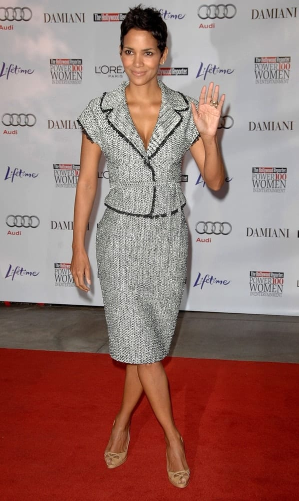 Halle Berry wore a Giambattista Valli silver suit at The Hollywood Reporter's Annual Power 100 Women in Entertainment Issue Breakfast in Beverly Hilton Hotel, Beverly Hills on December 4, 2009. She paired this with a tousled pixie hairstyle and fashionable shoes.