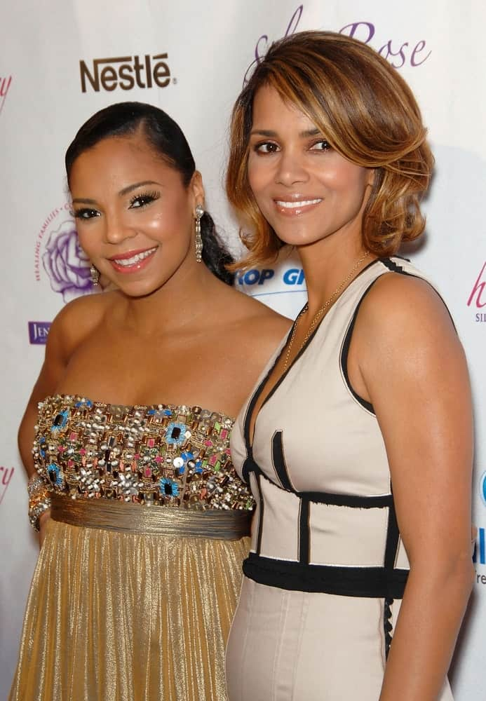 Ashanti and Halle Berry were at Silver Rose Gala and Auction Benefit held at the Beverly Hills Hotel and Bungalows in Los Angeles, CA on April 18, 2009. Berry paired her dress with a short bob hairstyle with highlights and a side-swept bangs.