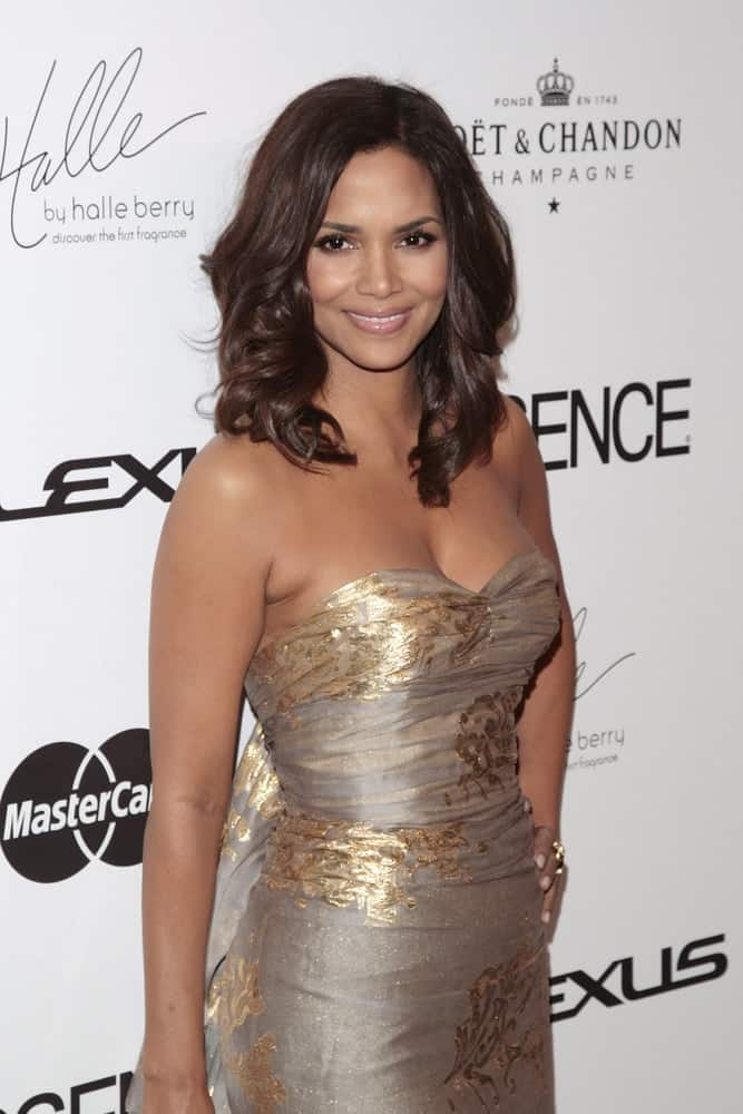 Halle Berry's strapless silver and gold dress was a nice pairing for her shoulder-length wavy hairstyle with layers at the Essence Black Women in Hollywood luncheon held at the Beverly Hills Hotel in Beverly Hills, California on February 19, 2009.