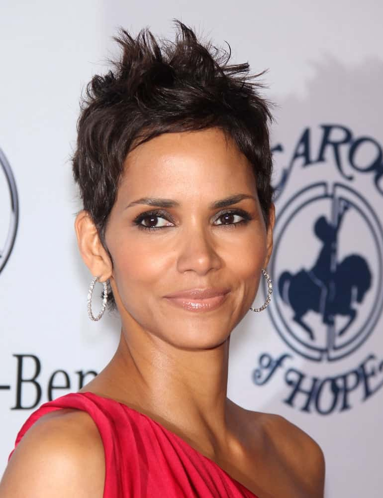 Halle Berry wore a goddess-cut red dress to match her equally sexy pixie hairstyle with a slight tousle and spikes at the Carousel of Hope 2010 on October 23,2010 in Beverly Hills, CA.