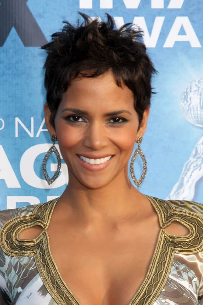 Halle Berry's awesome earrings perfectly match her dress spiked pixie hairstyle when she arrived at the 42nd NAACP Image Awards at Shrine Auditorium on March 4, 2011 in Los Angeles, CA.