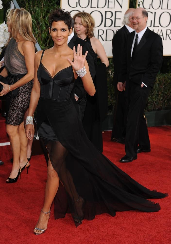 Halle Berry waved at her fans with her sexy black dress and spiky tousled pixie hairstyle when she arrived at the 68th Annual Golden Globe Awards on January 16, 2011 in Beverly Hills, CA.