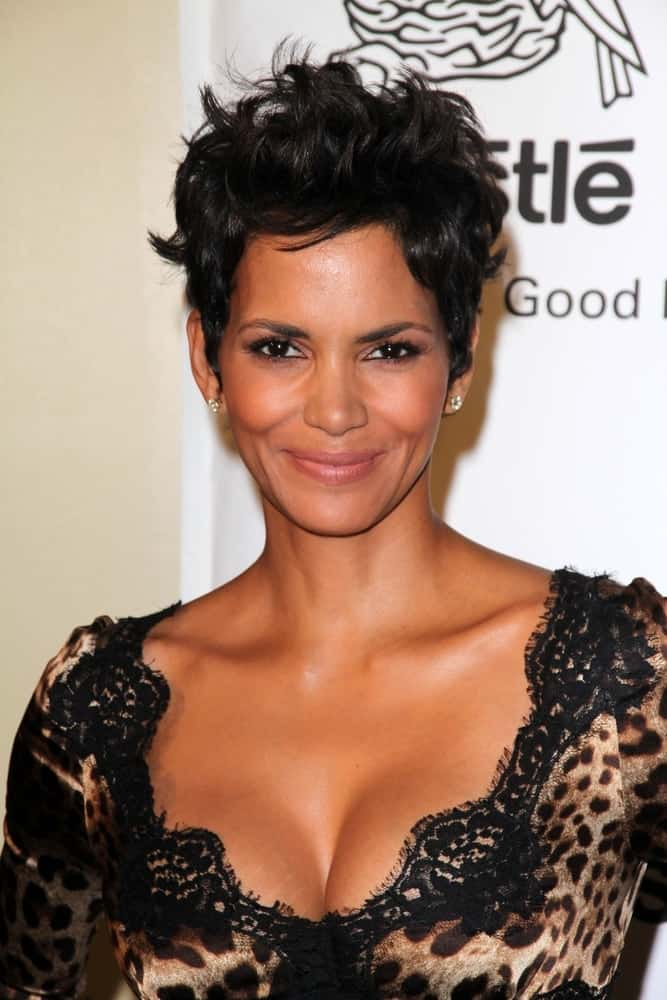 On April 14, 2012, Halle Berry flashed her beautiful smile with her animal print dress and tousled raven pixie hairstyle at the 2012 Silver Rose Gala, Beverly Hills Hotel in Beverly Hills, CA.