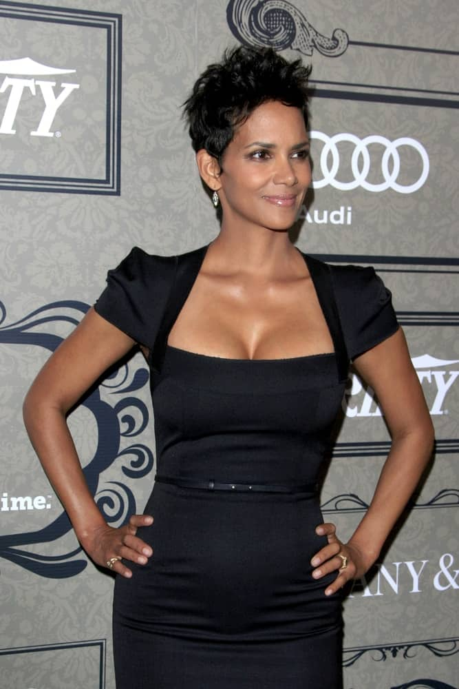 Halle Berry stunned everyone with her sexy black dress that pairs well with her tousled and spiky pixie hairstyle at the Variety's 4th Annual Power Of Women Event at Beverly Wilshire Hotel on October 5, 2012 in Beverly Hills, CA.