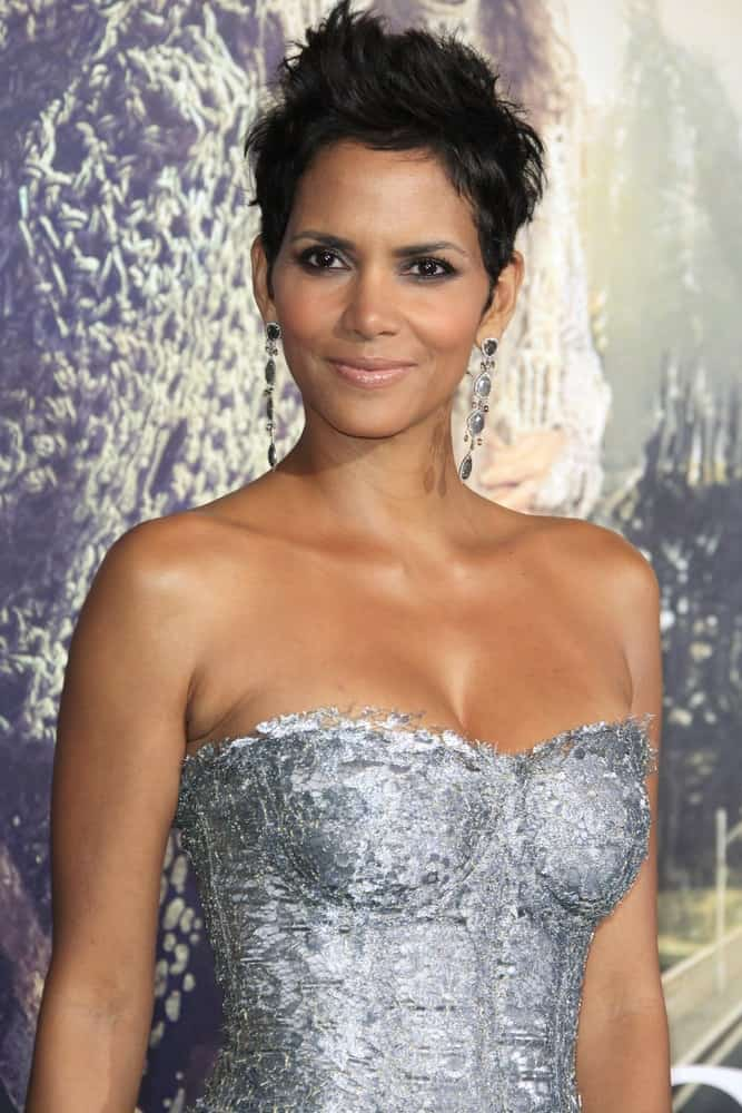 Halle Berry emphasized her lovely neckline with a strapless silver dress and a spiked pixie hairstyle that has a slight side-swept finish at the Warner Bros. Pictures' 'Cloud Atlas' premiere at Grauman's Chinese Theater on October 24, 2012 in Los Angeles, California.