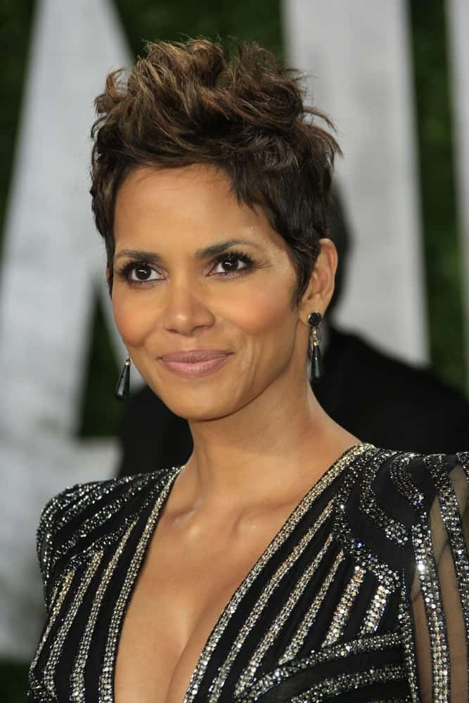Halle Berry's spiked pixie hair had a slight faux-hawk look with highlights at the Vanity Fair Oscar Party at Sunset Tower on February 24, 2013 in West Hollywood, California.