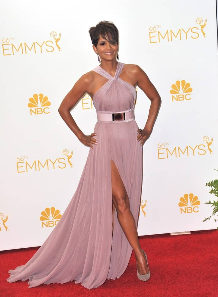 On August 25, 2014, Halle Berry was at the 66th Primetime Emmy Awards at the Nokia Theatre L.A. Live in downtown Los Angeles. She wore a beautiful long dress with matching shoes and a pixie hairstyle with long side-swept bangs.