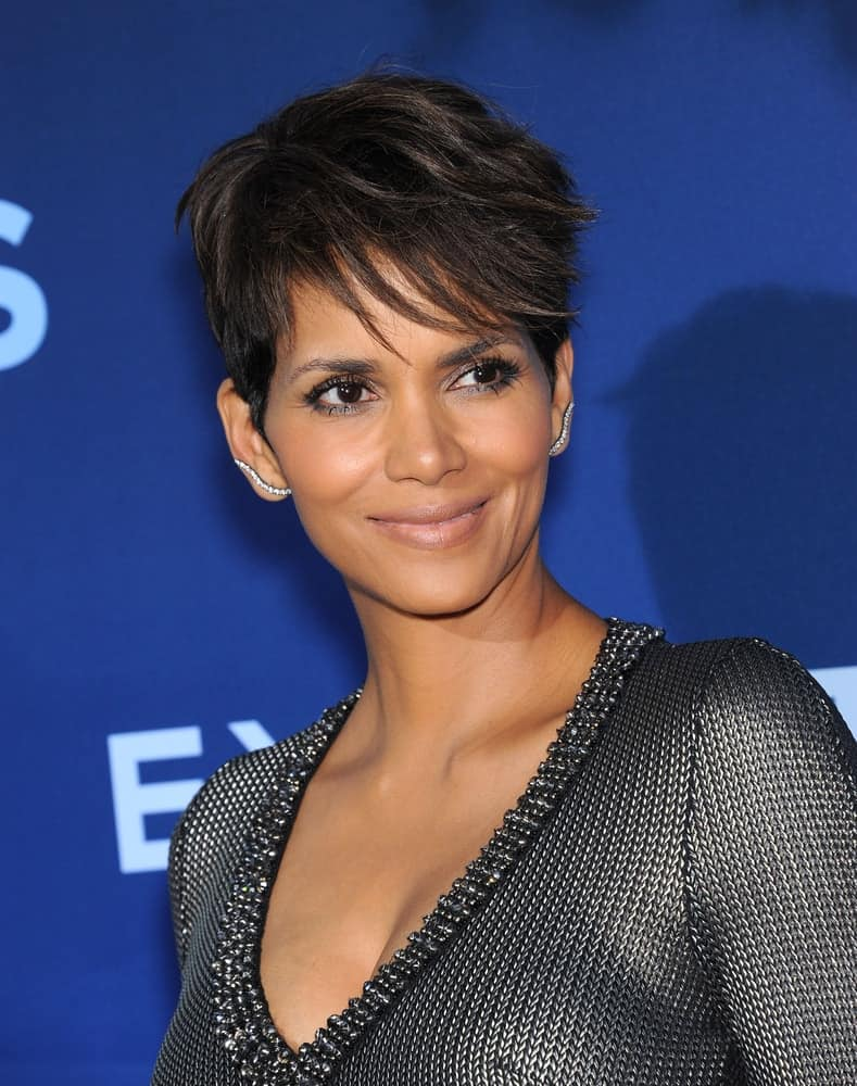 Halle Berry attended the 'Extant' Premiere Party on June 06, 2014 in Los Angeles, CA. She wore a stylish metallic gray dress that she paired with her raven pixie hairstyle with side-swept wispy bangs.