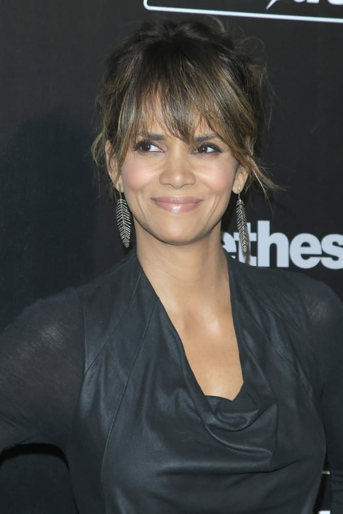 Halle Berry showed off her lovely earrings with her messy bun hairstyle that has loose bangs at the Fallout 4 video game launch at the downtown on November 05, 2015 in Los Angeles, CA.
