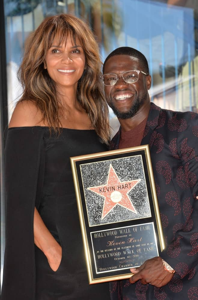 On October 10, 2016, Halle Berry attended the Hollywood Walk of Fame Star Ceremony honoring comedian Kevin Hart. She wore a black dress that she paired with a loose and tousled highlighted hairstyle with waves and bangs.