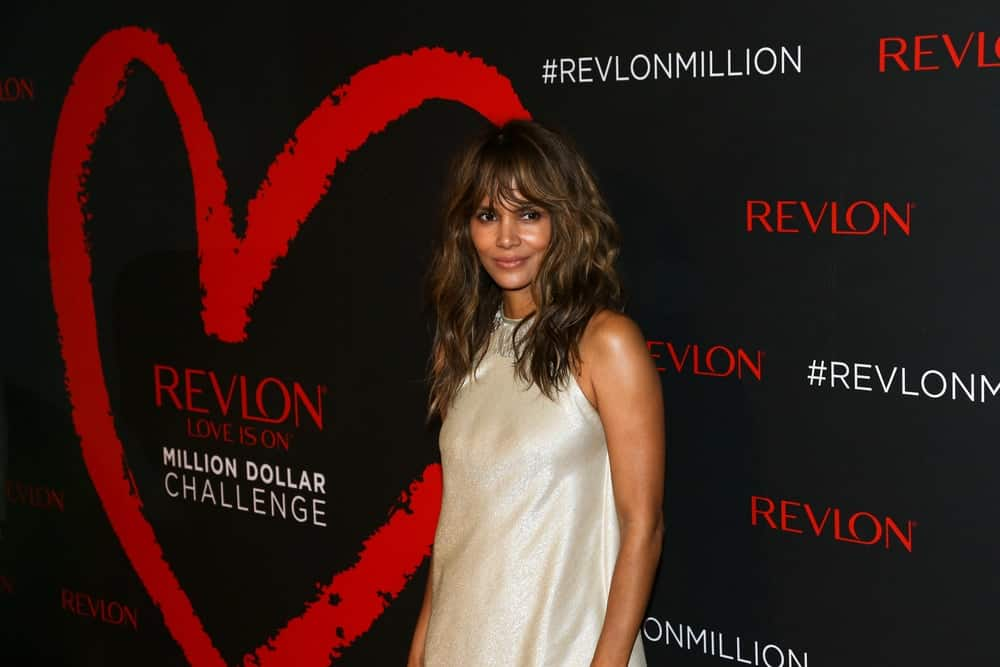 Actress Halle Berry attended Revlon's 2nd Annual Love Is On Million Dollar Challenge Finale Party at The Glasshouses on December 1, 2016 in New York City. She was stunning in her simple pearl white dress that complemented her loose and tousled wavy highlights.