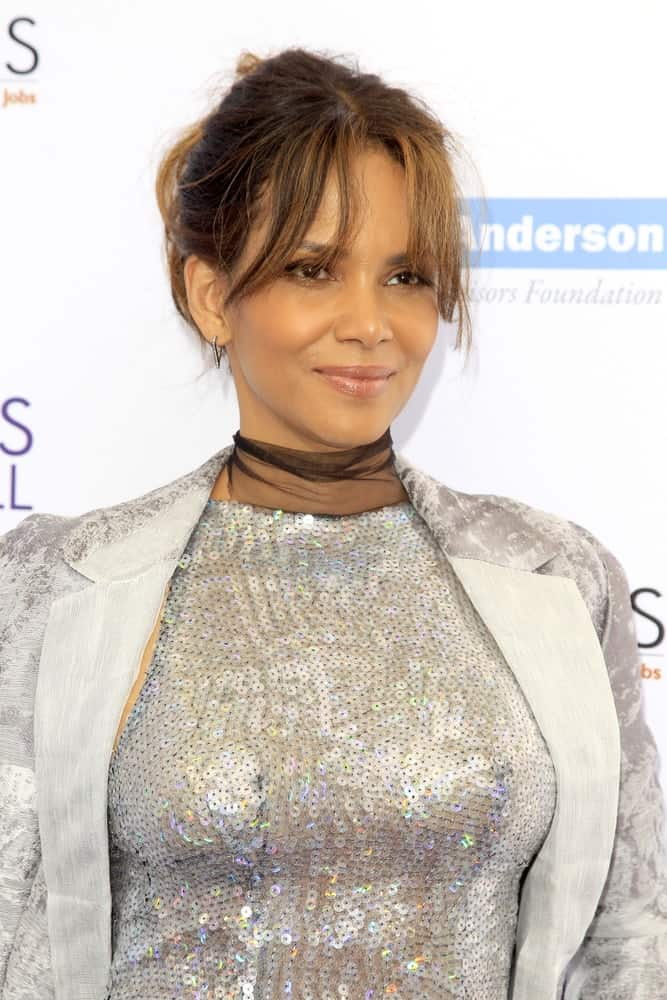 Halle Berry wore a stunning silver sequined dress that paired quite well with her messy bun hairstyle that has highlights and wispy bangs at the 16th Annual Chrysalis Butterfly Ball at the Private Estate on June 3, 2017 in Los Angeles, CA.