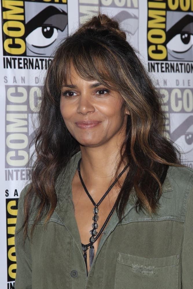 Halle Berry wore a green casual dress to pair with her loose and tousled half-up hairstyle with a bun at the