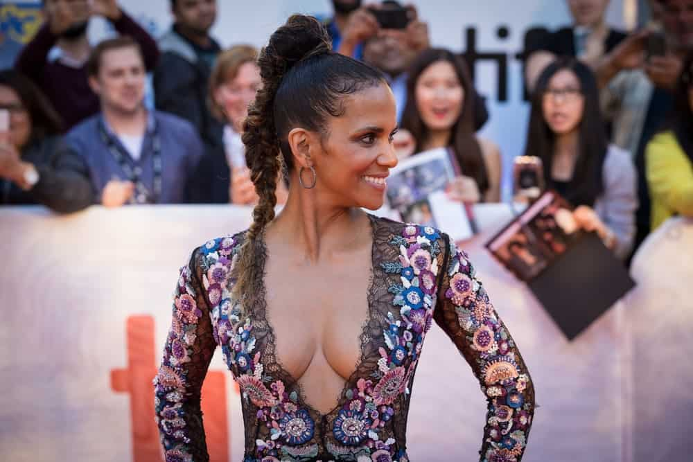 On September 13, 2017, Halle Berry looked radiant with her floral outfit and high ponytail with a fishtail braid at Roy Thompson Hall, at the premiere of Kings in the Toronto International Film Festival.