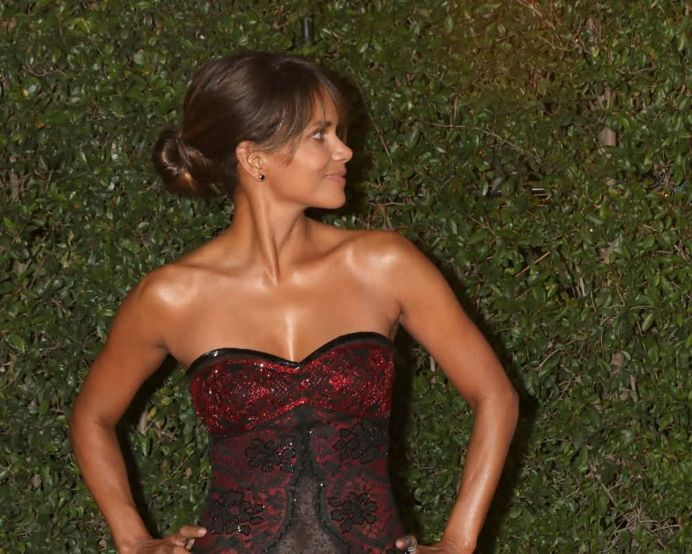 Halle Berry was quite elegant in her strapless red dress and bun hairstyle with highlights and bangs at the 49th NAACP Image Awards - Arrivals at Pasadena Civic Center on January 15, 2018 in Pasadena, CA.