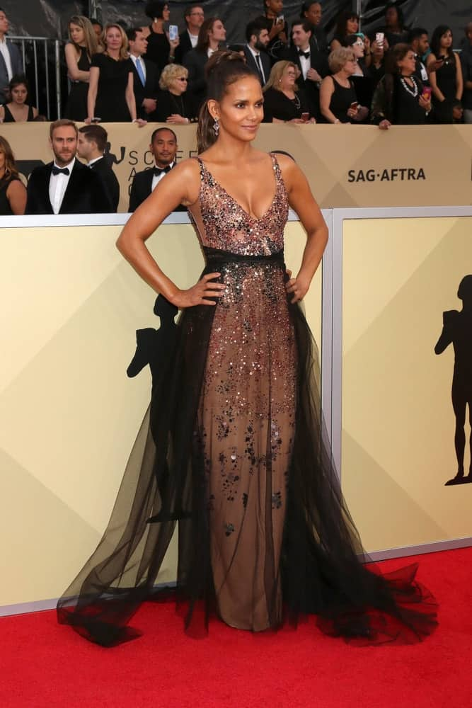 Halle Berry was at the 24th Screen Actors Guild Awards - Press Room at Shrine Auditorium on January 21, 2018 in Los Angeles, CA. She wore a gorgeous bejeweled gown that went quite well with her ponytail hairstyle with a high bun.