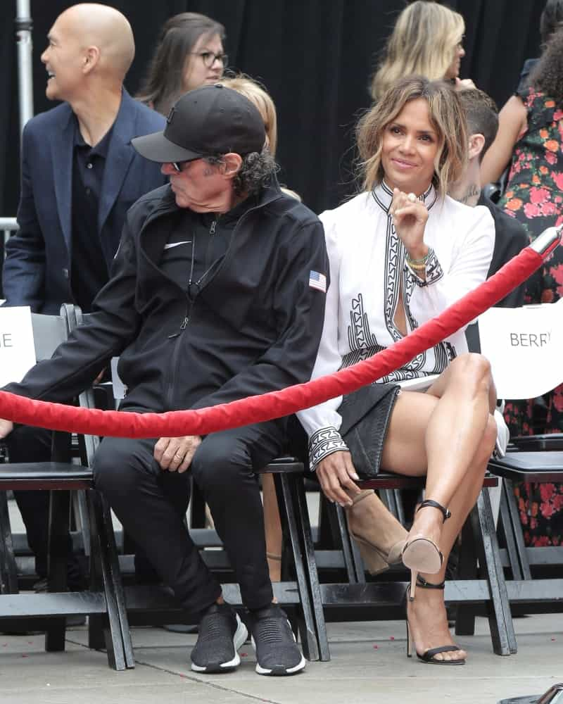 Halle Berry attended the Keanu Reeves Hand and Foot Print Ceremony at the TCL Chinese Theater IMAX on May 14, 2019 in Los Angeles, CA. She wore lovely smart casual outfit that paired well with her loose and tousled low ponytail with wavy bangs.