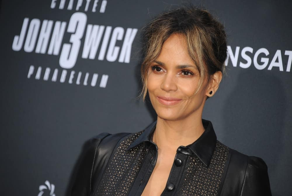 Halle Berry was at the Los Angeles premiere of 'John Wick: Chapter 3 - Parabellum' held at the TCL Chinese Theatre in Hollywood on May 15, 2019. She wore a lovely black leather outfit that she paired with her upstyle that has wispy highlighted curtain bangs.