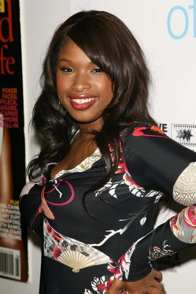 Jennifer Hudson was at the Hollywood Life Magazine's Breakthrough of the Year Awards in Music Box, Hollywood, California on December 10, 2006. She wore a black patterned sundress with her long and wavy raven hairstyle that has layers and long side-swept bangs.