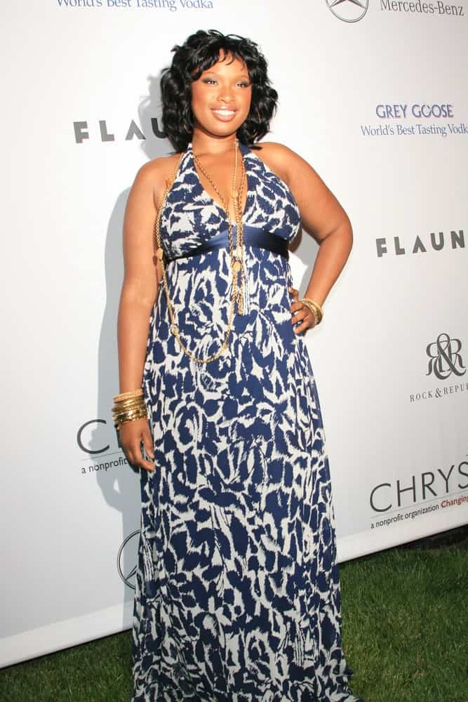 Jennifer Hudson was at the Chrysalis Butterfly Ball at a private mansion, Los Angeles, California on June 2, 2007. She wore a sundress with her shoulder-length curly hairstyle with a slight tousle.