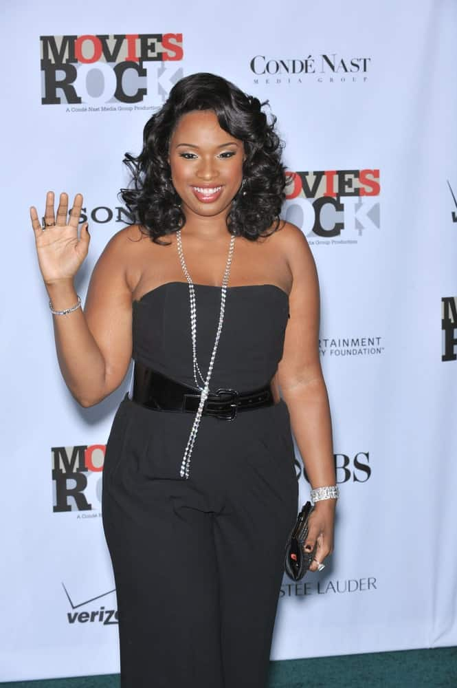 Jennifer Hudson attended the Movies Rock: A Celebration of Music in Film at the Kodak Theatre, Hollywood on December 2, 2007. She paired her all-black strapless outfit with a shoulder-length tousled curly raven hairstyle with side-swept bangs.