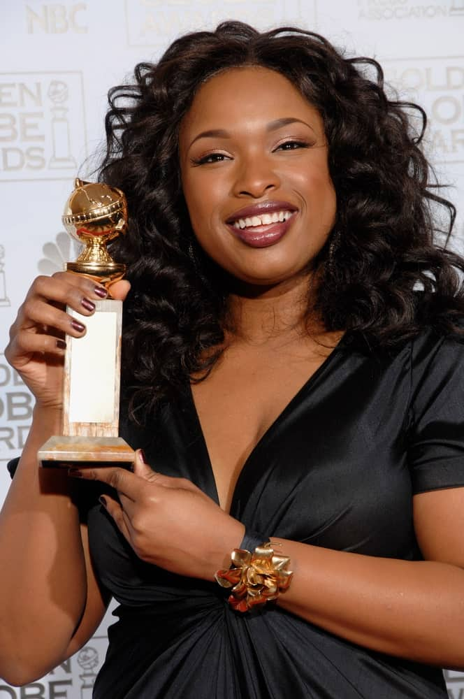 Jennifer Hudson was at the 64th Annual Golden Globe Awards at the Beverly Hilton Hotel on January 15, 2007. She wore a black dress with her shoulder-length curly hairstyle that is tousled.