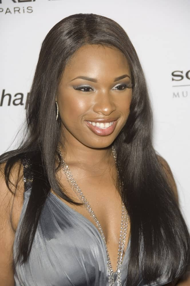 Jennifer Hudson was at the Clive Davis pre-Grammy Party at the Beverly Hilton Hotel on February 11, 2007. She paired her sexy gray dress with a long and straight layered hairstyle.