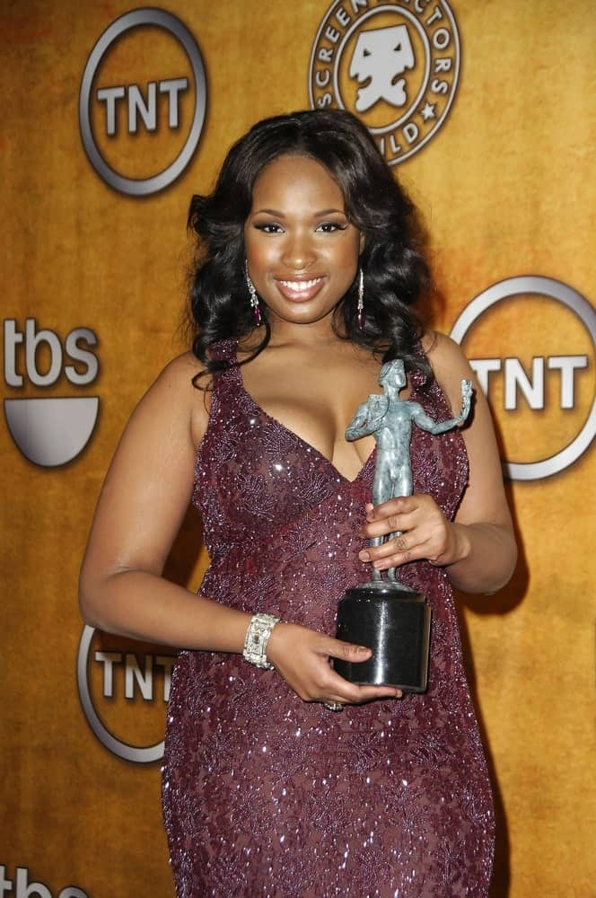 Jennifer Hudson was in the press room for SAG 13th Annual Screen Actors Guild Awards at The Shrine Auditorium in Los Angeles, CA on January 28, 2007. She paired her shimmery purple dress with a shoulder-length raven hairstyle that has a slight tousle and vintage curls.