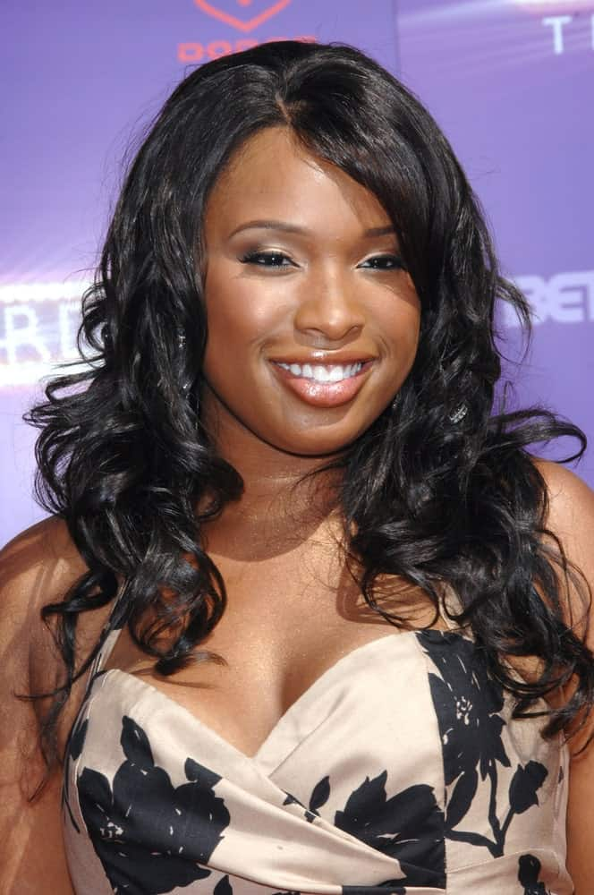 Jennifer Hudson attended the 2007 BET Awards at the Shrine Auditorium, Los Angeles on June 26, 2007. She was charming in a strapless dress that she paired with a long and curly raven hairstyle with a slight tousle and side-swept bangs.