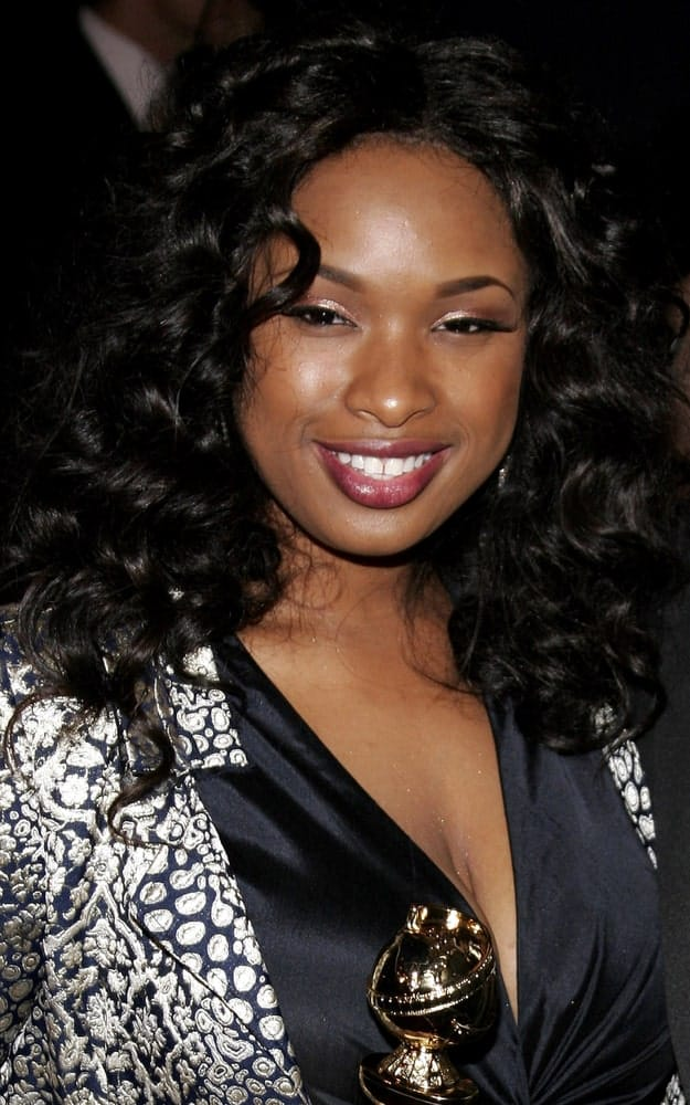 Jennifer Hudson attended the 2007 Paramount Pictures Golden Globe Award After-Party held at the Beverly Hilton Hotel in Beverly Hills, California, on January 15, 2007. She paired her trophy and black dress with a loose and tousled curly hairstyle.