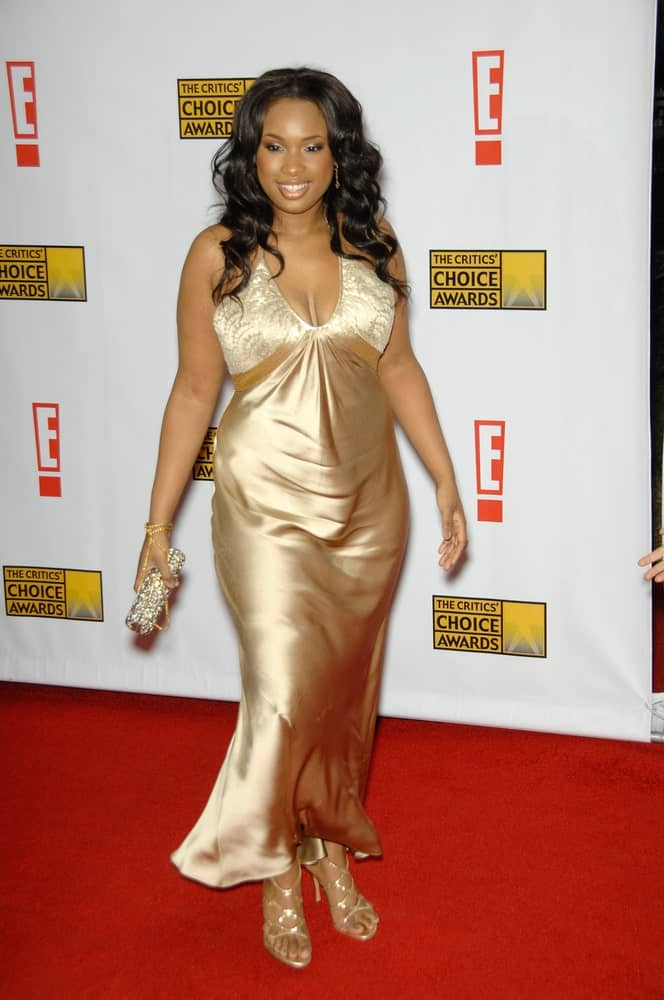 Jennifer Hudson was at the 12th Annual Critics' Choice Awards at the Santa Monica Civic Auditorium on January 12, 2007. She paired her golden dress with a long and wavy raven hairstyle with a slight tousle.