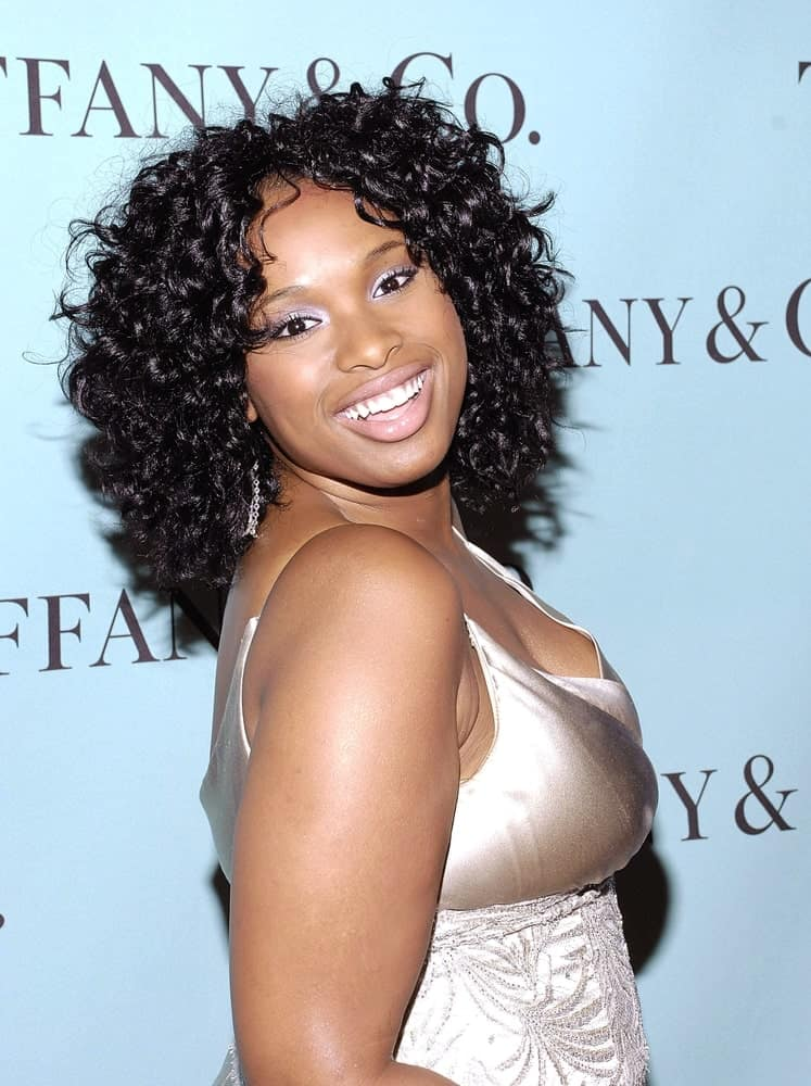 Jennifer Hudson was at the Launch of the Tiffany 2008 Blue Book Collection at the American Museum of Natural History in New York, NY on October 27, 2007. She paired her golden dress with a loose and tousled shoulder-length curly hairstyle.