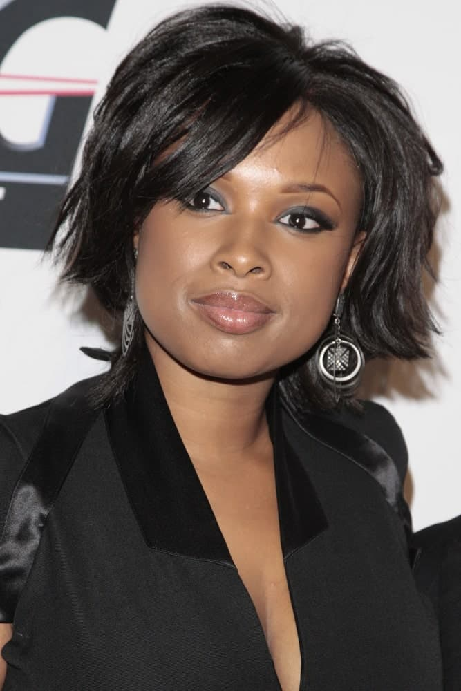 Jennifer Hudson attended the Clive Davis and The Recording Academy present the Annual Pre-Grammy Gala in Beverly Hills, California on February 7, 2009. She paired her black dress with a short chin-length tousled raven hairstyle with layers and side-swept bangs.